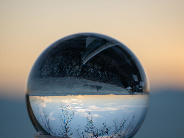 Close-up Glass - Material Nature Sphere No People Reflection Sky Transparent Sunset Crystal Ball Focus On Foreground Indoors  Geometric Shape Still Life Shape Copy Space Single Object Winter Cold Temperature