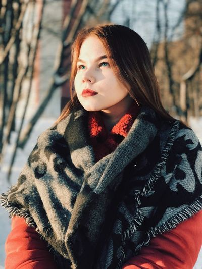 Close-Up Of Woman Standing In Forest During Winter