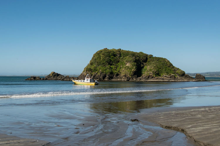 Fisher boat near Ancud 2016 Ancud Beach Beauty In Nature Castro, Chile Chile Chiloé, Chile Day Fisher Boat Growth Los Lagos Nature NIKON D5300 No People Outdoors Pacific Sand Scenics Sea Sky Tranquil Scene Tranquility Travel Destinations Tree Water This Is Latin America