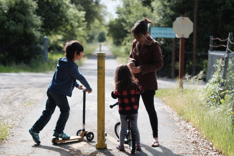 Woman and two children on footpath