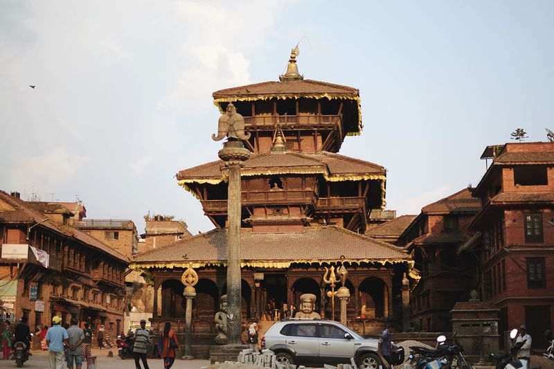 Bhaktapur. Religion Nepal Hinduism Temple Place Of Worship EyeEm Selects Built Structure Building Exterior Architecture Sky Building City Travel Travel Destinations Tourism History The Past Group Of People