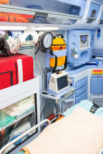 Ambulance of Red Cross Crash Doctor  ECG EMS Emergency Injured Medicine Nurse Paramedic Ambulance Ambulance Service Defibrillator Disaster Flashlight Heart Ictus Inside Red Cross Rescue Trauma