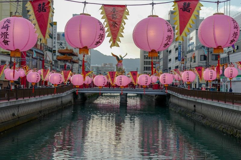 Evening shot Nagasaki Shinchi Chinatown : Pink Lanterns water reflection 17:27 1st March 2018 ( Japan Standard Time ). Nagasaki today on the bridge LEICA Q 50mm ( Digital Frame Selector) f/2.0 No filter No crop Handheld de Good evening Nagasaki Scapes なんちゃってSUMMICRON Lantern Pink Color Today's Hot Look 長崎ランタンフェスティバル NAGASAKI LANTERN FESTIVAL Nagasa-Kirei ( ナガサキレイ ) On The Bridge LEICA Q 50mm F/2.0 No Filter Manual Mode Photography Chinese Lantern Lantern Chinese Lantern Festival Traditional Festival Chinese New Year Outdoors No People