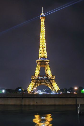 Low angle view of illuminated tower