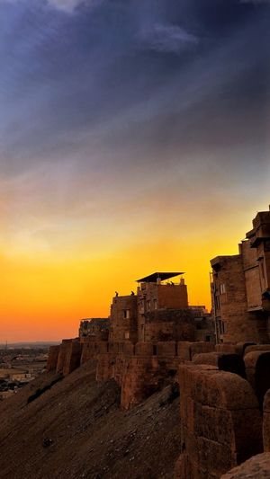 Sunset to remember at Jaisalmer Fort India PhonePhotography EyeEm Best Shots EyeEmNewHere Sky Sunset History Architecture The Past Built Structure Ancient Building Exterior Orange Color No People Cloud - Sky Travel Destinations Tourism Scenics - Nature Old Ruin Old Travel Outdoors Building
