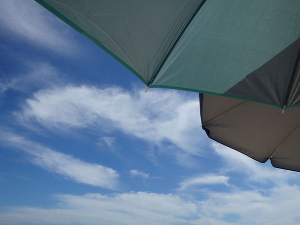 In the shade, bring it with you. Beachlife Beachumbrella Sky The Essence Of Summer