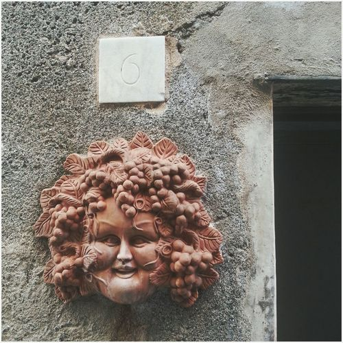 """Bacco"". Bacco tabacco e Venere riducono l' uomo in cenere / Bacchus tobacco and venus make ashes out of a man :) / Details Decorations Wall Wine Shop Street Photography Relief Rilievo in Terracotta Mobile Photography BACK to Galaxy Note II yuppy! Note 2 Snapseed Eyeemfilter F1"