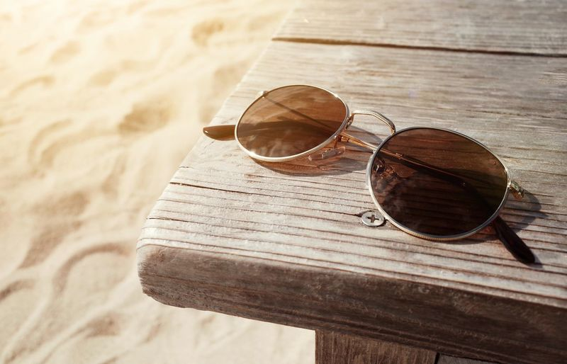 Close-up of sunglasses on table