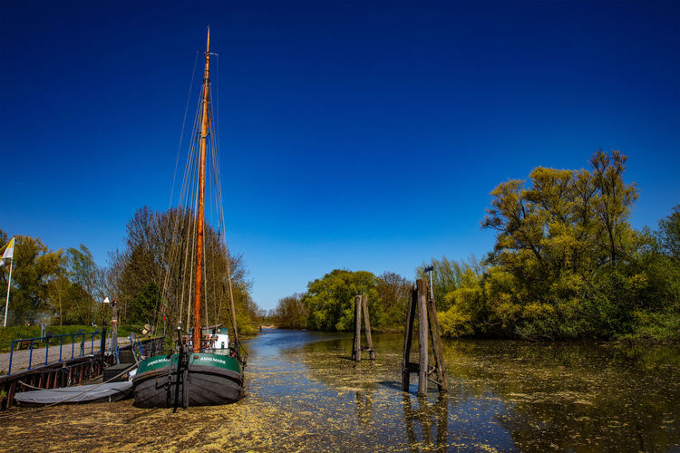 Water Nautical Vessel Tree Sky Transportation Plant Mode Of Transportation Blue Clear Sky Nature Moored Day Beauty In Nature No People Scenics - Nature Sailboat Outdoors Old Harbour Lastensegler