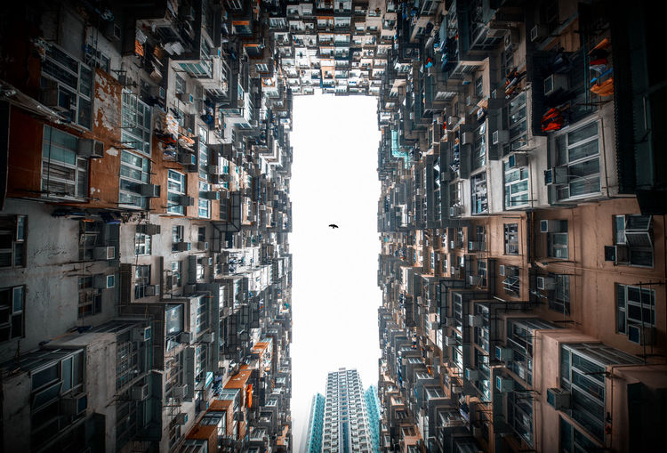 The crowed city buildings Architecture Building Exterior Building Built Structure City Tall - High Residential District No People Skyscraper Window Sky Apartment Day Outdoors Directly Below Modern Tower Low Angle View City Life Freedom Bird First Eyeem Photo Poor  Narrow Up Close Street Photography
