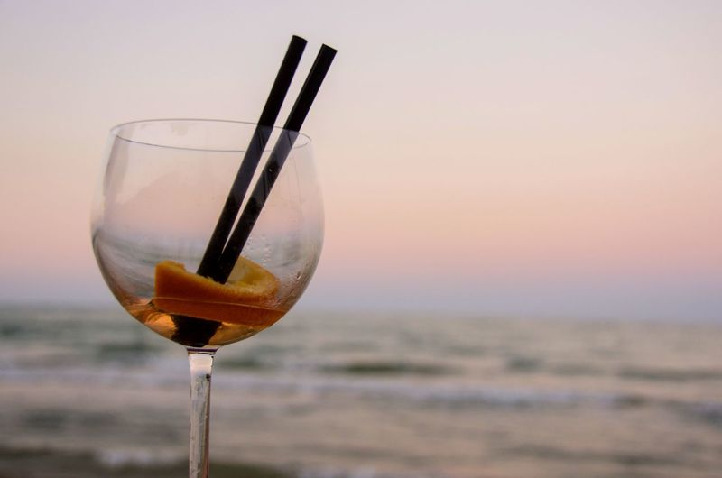 Drink Food And Drink No People Day Drinking Glass Wine Sun SeaAlcohol EyeEm Selects Italia Multi Colored Pink Color Beach Travel Sunset Sky Wineglass Party - Social Event Close-up Outdoors Liqueur Winetasting