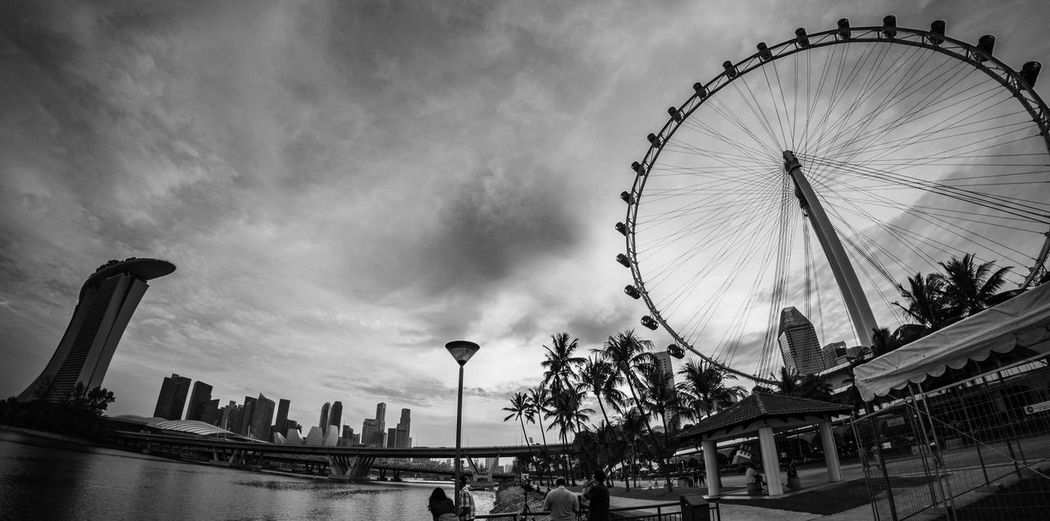 Dawn over Singapore Marina Bay Sands Singapore Amusement Park Amusement Park Ride Architecture Building Exterior Built Structure City Cloud - Sky Day Ferris Wheel Low Angle View Office Building Exterior Singaporeflyer Sky Travel Travel Destinations Water A New Beginning