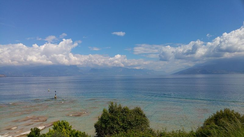 Nature Blue Sea Sky Beauty In Nature Water Beach Outdoors Scenics Tranquility Day Tree No People Cloud - Sky Landscape Horizon Over Water Lagodigarda Sirmione Italy Vacations Beauty In Nature View Lake Lago Di Garda Landscapes Neighborhood Map