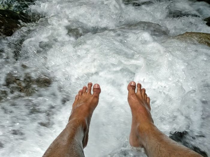 Low section of feet above flowing water