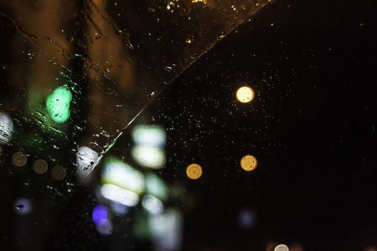 Car Lights Rain RainDrop Car Car Window City Close-up Defocused Drop Focus On Foreground Glass - Material Illuminated Light Night No People Outdoors Rain Rain On Car Rain On Car Window Rain On Window RainDrop Rainy Season Water Wet Window