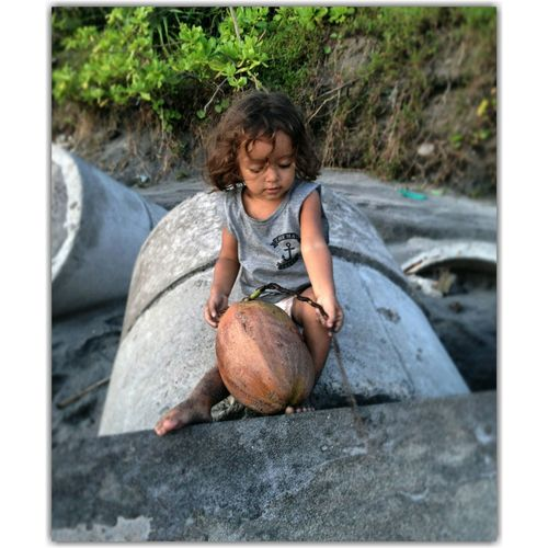 Moana Beachbaby Islandlife Island Islandchild Coconut EyeEm Selects Child Childhood Full Length Water Smiling Tree Curly Hair Front View Happiness Sitting Shore Growing Coast