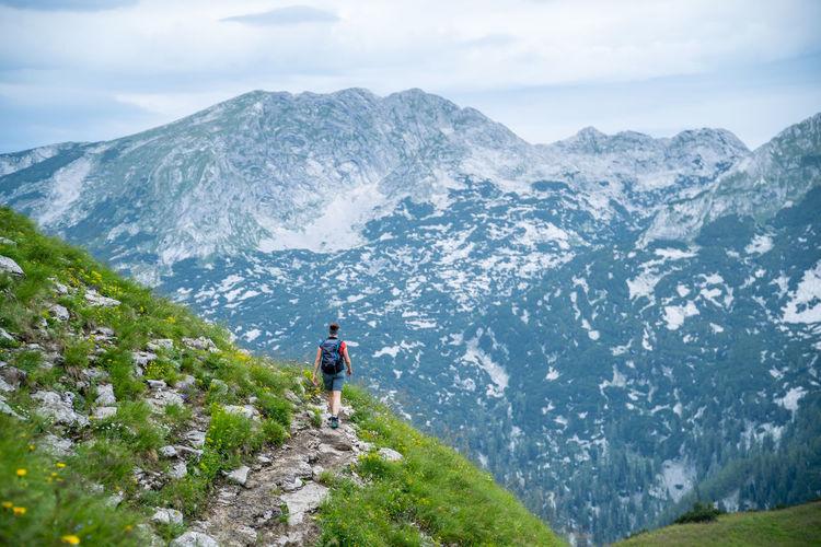 Woman hiking on alpine footpath in the austrian alps, loser mountain region, austria