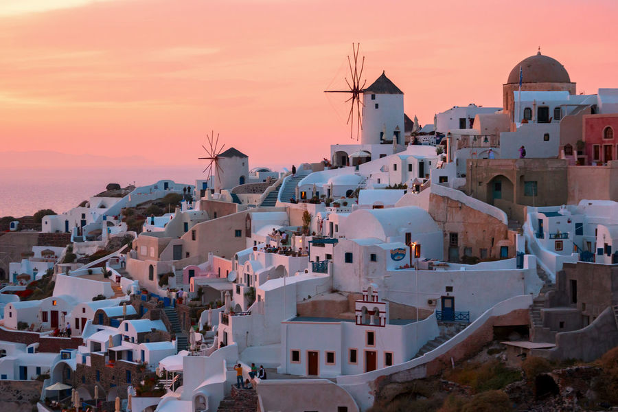 Oia, Santorini, Greece City Cityscape Windmill Architecture Beauty In Nature Building Exterior Built Structure Day Nature No People Outdoors Sea Sky Sunset Town Travel Destinations Water