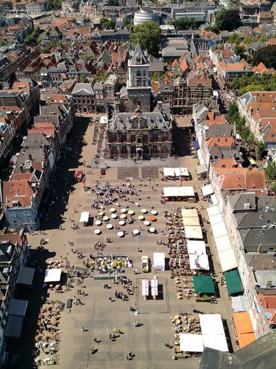 View of Delft Market Square from Nieuwe Kerk (New Church), Delft, Netherlands Day Roof Tops Rooftops Roofs Dutch Public Space Public Event Historic New Church Nieuwe Kerk Town Hall People Event Sunny Town Old High Angle Above Aerial Markt Europe Square Architecture Netherlands Delft
