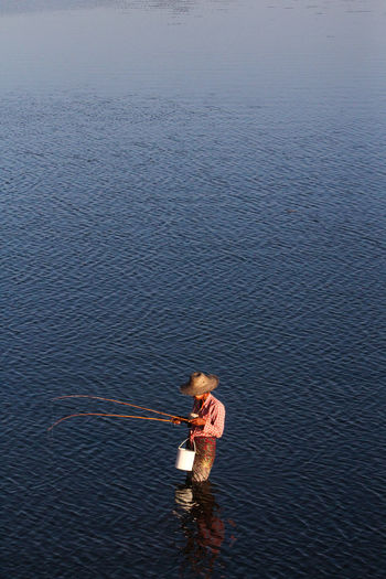 High angle view of man fishing in the sea