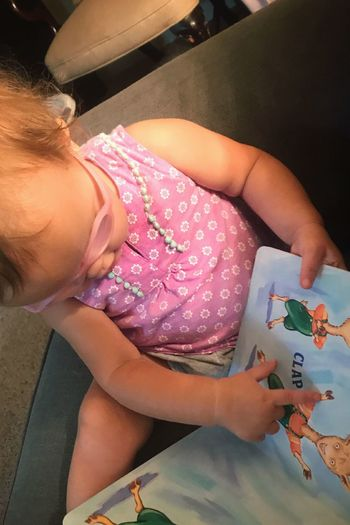Baby loves to read! Real People Baby Infant Reading One Person High Angle View Indoors  Childhood Day Baby With Glasses Book Picture Book Learning Literary Cute Childhood Child Learns Curiosity Learning To Read Preschool Preschool Age
