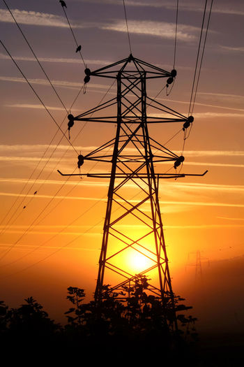 National Grid Beauty In Nature Built Structure Cable Cloud - Sky Complexity Connection Electrical Equipment Electricity  Electricity  Electricity Pylon Electricity Supply Fuel And Power Generation Low Angle View Nature No People Orange Color Outdoors Plant Power Line  Power Supply Silhouette Sky Sunset Technology