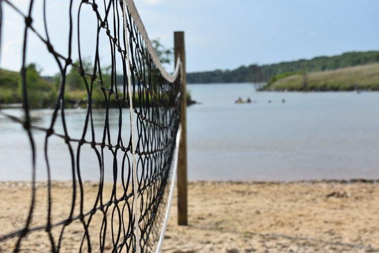 Close-up of net on beach