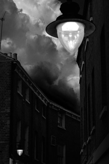 Old world Lamp Buildings Terraced Houses Clouds Cloudporn Architecture London Dark Darkness And Light Black And White Shadows & Lights No People Hanging Building Exterior Storm Cloudy Sky Imposing Monochrome Composition Scene London Eye London Streets Streetphotography Street Photography