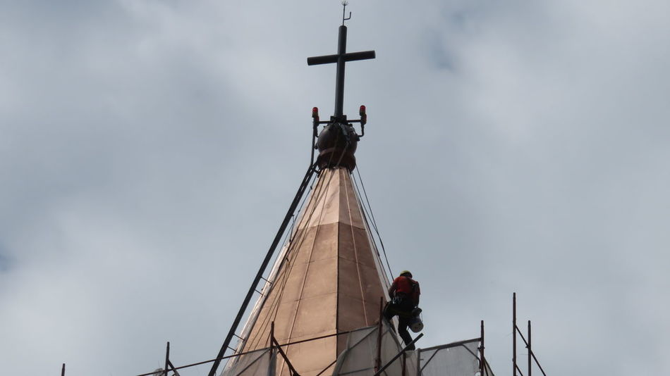 Worker at work on church bell tower Bell Tower Building Exterior Church Tower Climber Climbing Construction Danger Equipment Extreme Job Outdoors RISK Risky Ropes Work