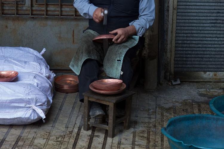 Artisan Artisan Artistic Artistic Expression Copper Art Craftsmanship  Expertise Hammer Handicrafts Kahramanmaraş Pick Pounding  Sitting Skilled Trades Skilled Work Tools Towel Tradesman Turkey Working