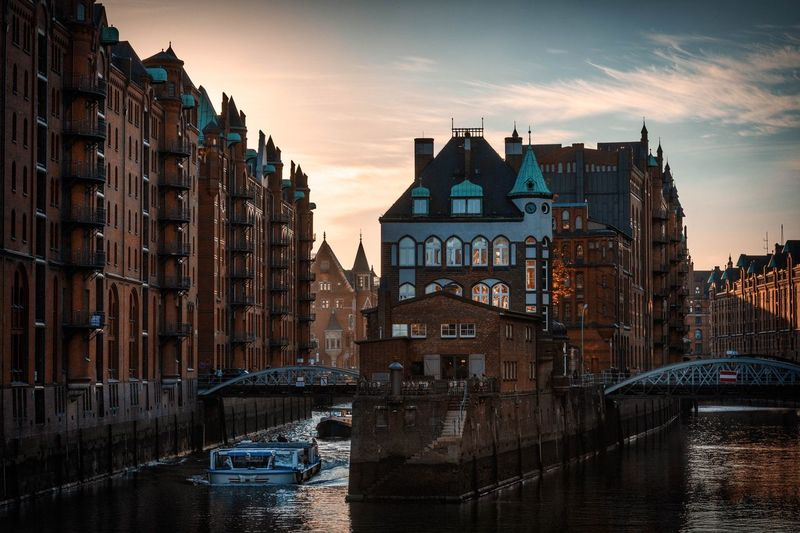 Wasserschloss in Speicherstadt Architecture Building Exterior Built Structure Building Sky City Water Sunset Cityscape Tower Cloud - Sky History Tall - High Office Building Exterior Skyscraper Residential District No People Nature Travel Destinations The Past
