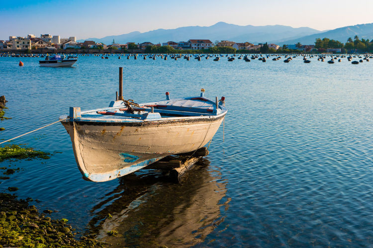 Boat suspended Beauty In Nature Blue Boat Calm Day Idyllic Italy Messina Mode Of Transport Mountain Nature Nautical Vessel Non-urban Scene Outdoors Rippled Scenics Sicily Sky Tourism Tranquil Scene Tranquility Transportation Travel Destinations Water Water Vehicle