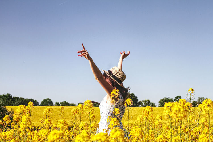 Arms Raised Beauty In Nature Clear Sky Day Field Flower Flowering Plant Growth Hand Human Arm Human Limb Land Landscape Leisure Activity Limb Nature Oilseed Rape One Person Outdoors Plant Rapeseed Real People Rural Scene Sky Yellow #FREIHEITBERLIN