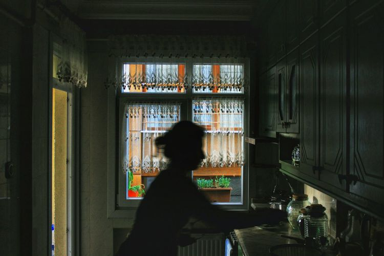 Silhouette of person cooking in kitchen