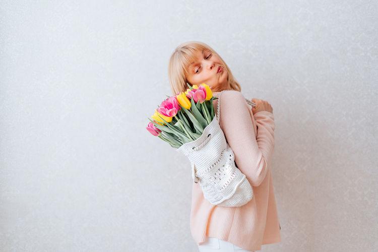 Portrait of a girl holding white flower