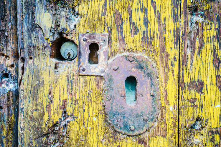 Full frame shot of old rusty metal door