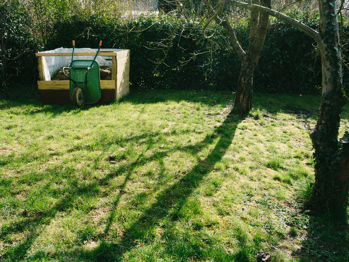 Branches Compost Copy Space Day Garden Gardening Grass Green Color Growth Nature No People Outdoors Shadows & Lights Spring Sunny Day Tree Composting Wheelbarrow