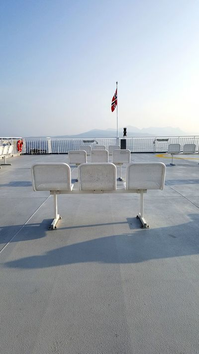 Hello World Hows it going? Look Here's a Photo I took Last Summer Check It Out On The Ferry Ferryboat Flag Benches Railing Lifebuoy Shadows & Lights Shadow Telling A Story Lonely Empty Seascape The Week Of Eyeem Followme