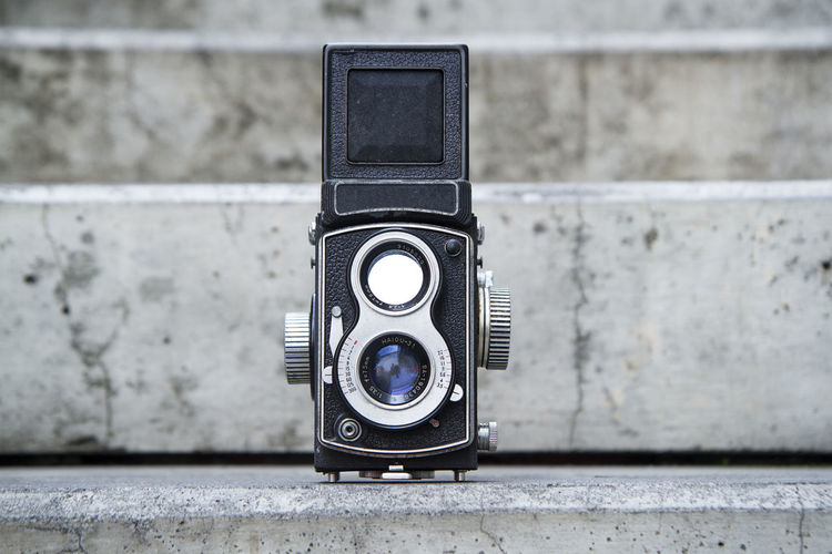 Close-up of vintage camera on wall