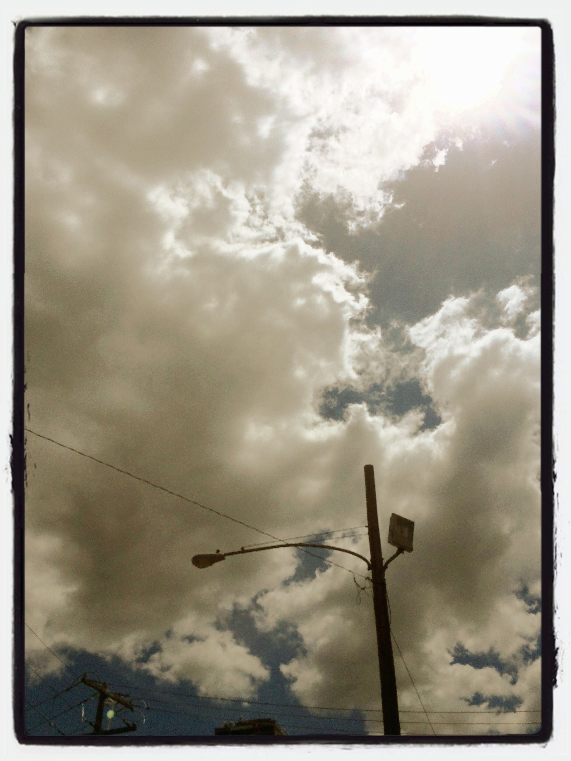 sky, transfer print, low angle view, cloud - sky, cloudy, auto post production filter, cloud, weather, overcast, power line, power supply, nature, electricity, technology, cloudscape, tranquility, connection, day, no people, outdoors