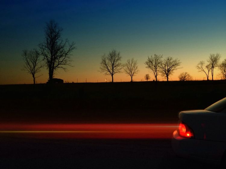 Transportation Sunset Illuminated Land Vehicle Car Mode Of Transport No People Sky Bare Tree Car Roof Tree Road The Drive Silhouette Clear Sky Outdoors Close-up Nature Night