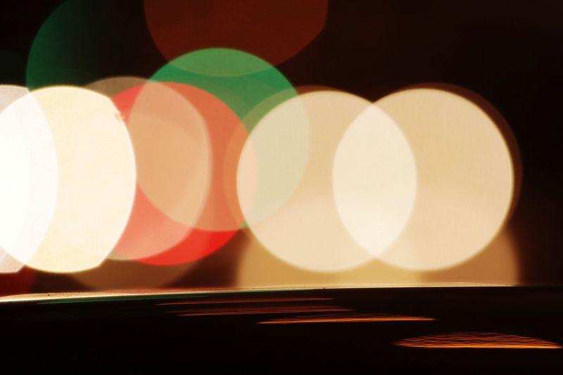 Urban nightscapea Night Lights Simple Traffic Light  Traffic Multi Colored Indoors  No People Illuminated Close-up Geometric Shape Circle Pattern Shape Design Light - Natural Phenomenon Lens Flare Creativity Arts Culture And Entertainment Still Life Lighting Equipment