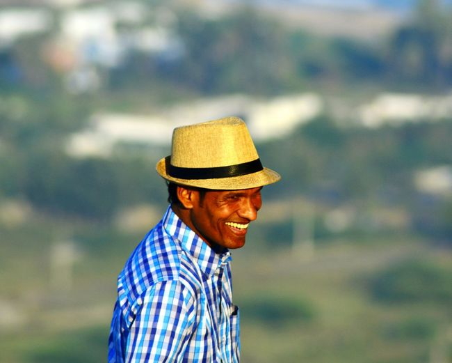 Cheerful Man In Sun Hat Outdoors