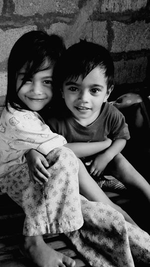 Cutify kids Embracing Happiness Indoors  TWOKIDS Bonding Smiling Boy And Girl Siblings Portrait Innocent Face Break The Mold Art Is Everywhere TCPM EyeEmNewHere Blackandwhite