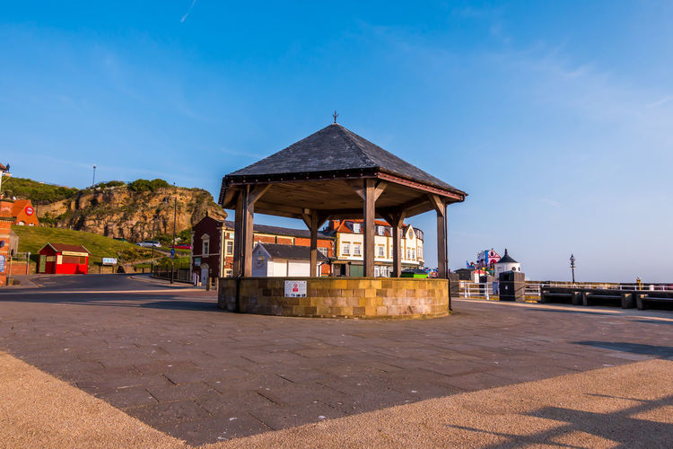 Whitby Whitby Harbour Whitby View Whitby North Yorkshire North Yorkshire Seaside Seaside Town Yorkshire Coast Tourist Destination Bandstand Band Stand Blue Sky Blue Architecture Outdoors Clear Sky Shadow No People Sunlight Sky Sunrise Summer Days Built Structure Building Exterior Building