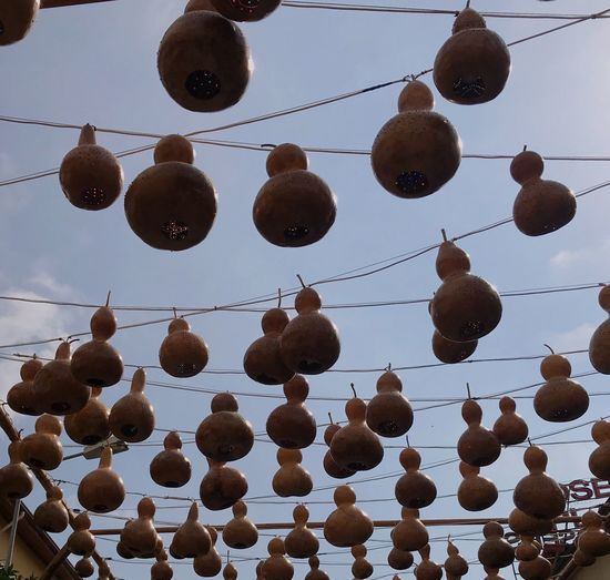 Calabash lightening✨ EyeEm Nature Lover EyeEm Best Shots EyeEmNewHere Light Hanging In A Row No People Low Angle View Architecture Cloud - Sky Large Group Of Objects Decoration Nature Sky Side By Side Outdoors Cable Repetition Celebration Day Order Lantern