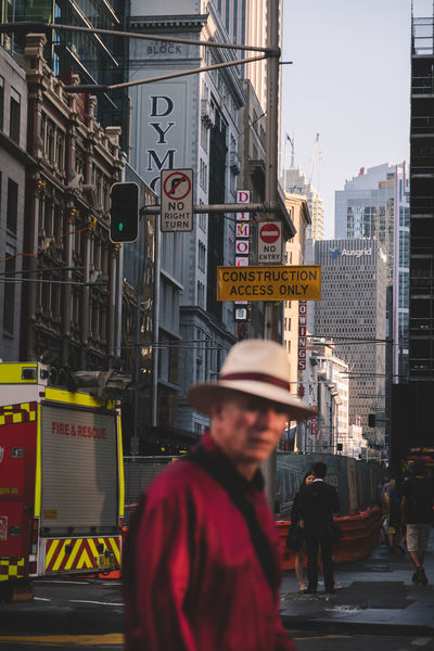 @itchban / www.itchban.com Adult Adults Only Blurred Foreground Blurred Subject Bokeh Building Exterior City City Street Day Men One Man Only One Person Only Men Outdoors People Real People Red Light Street Photography The Street Photographer - 2017 EyeEm Awards