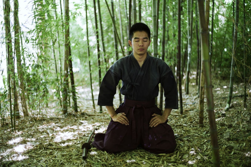 The modern samurai. Adult Adults Only Adventure Bamboo - Plant Day Forest Front View Full Length Looking At Camera Men Nature One Man Only One Person Only Men Outdoors People Portrait Real People Sitting Standing Tree Weapon WoodLand Young Adult