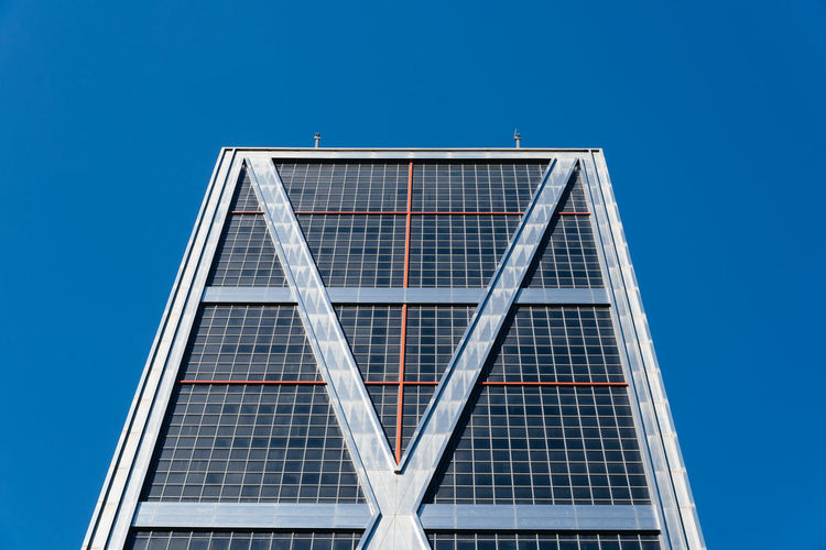 Leaning skyscraper in Madrid Business Kio Low Angle View Office Tourist Attraction  Travel Abstract Architecture Blue Blue Sky Building Exterior Built Structure City Clear Sky Day Landmark Low Angle View Modern No People Office Building Office Building Exterior Outdoors Sky Skyscraper Tower