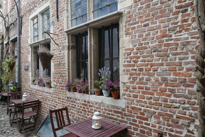 Architecture Building Exterior Flower Brick Wall Window Outdoors No People Restaurant Built Structure Table Chair City Day Wall - Building Feature Brick Wall Brick Bricks Building Old House Façade Architecture Photography Outdoor Photography
